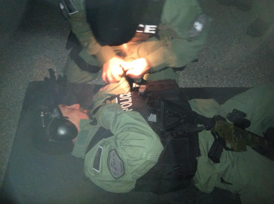 Night Training. Live fire while applying a tourniquet.